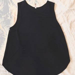 sleeveless black dress top with accent buttons